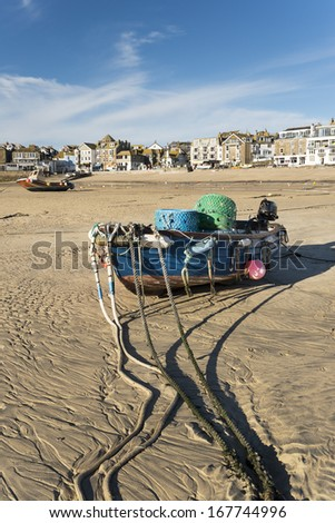 Fishing boat on the beach at St Ives in Cornwall - stock photo