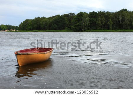 Fishing boat on the lake - stock photo