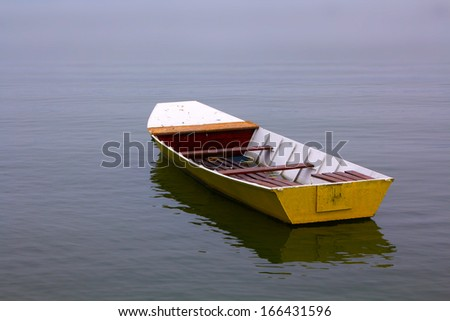 Fishing boat on the river.  - stock photo
