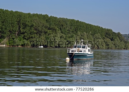 Fishing boat on the river. Fishing boat. - stock photo