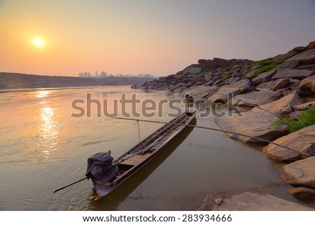 Fishing boat  on the river in the morning - stock photo
