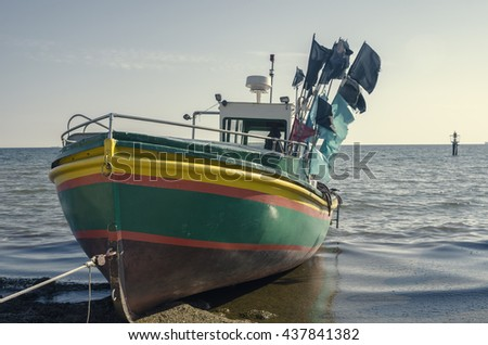 Fishing boat on the sea shore