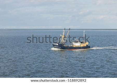 Fishing boat on the Wadden Sea near the island of Vlieland in the North of the Netherlands