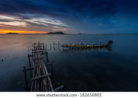 fishing boat with wooden bridge - stock photo