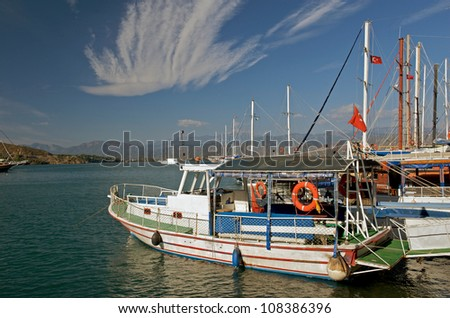 Fishing boats along the harbour front in Fethiye, Turkey. - stock photo