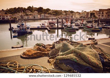 Fishing boats and nets in the harbor of Saint Jean de Luz in Pays Basque, France - stock photo