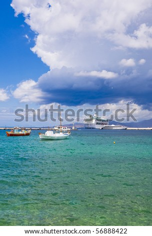 fishing boats at anchor in the Bay of Islands on the background of a beautiful sky with clouds...