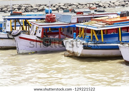 Fishing boats at anchor in the harbour at Mumbai, India. - stock photo