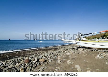 Fishing boats at beach - stock photo