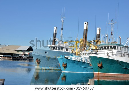 Fishing Boats at Dock and a Beautiful Blue Sky