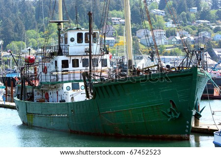 fishing boats at dock on the Oregon Coast - stock photo