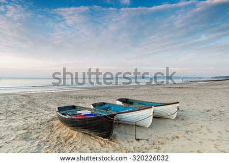 Fishing boats at Durley Chine on Bournemouth beach in Dorset - stock photo