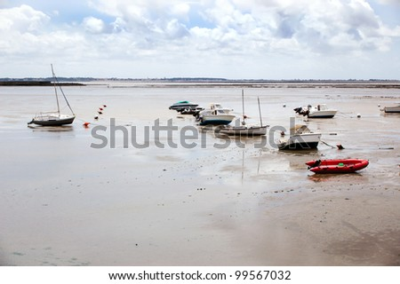 fishing boats during low tide, France, La Rochelle - stock photo