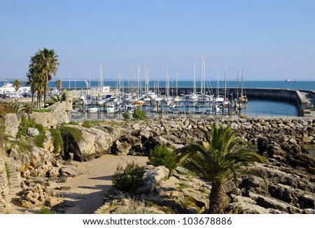 Fishing boats floating in the fish port of Cascais - Portugal - stock photo