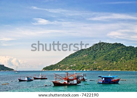 Fishing Boats in Emerald Sea - stock photo