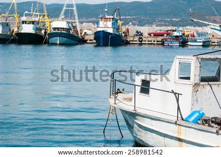 fishing boats in harbor - stock photo