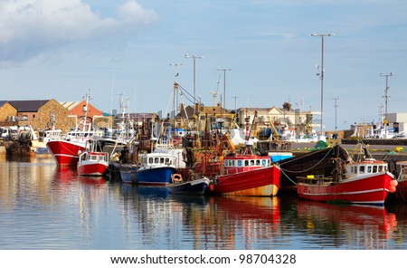 Fishing boats in Howth harbor in summer, county Dublin, Ireland.