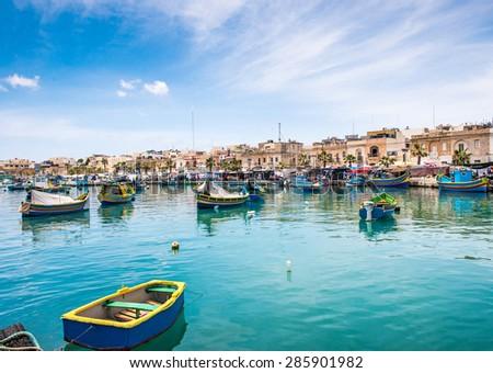 Fishing boats in Marsaxlokk harbor. Malta - stock photo
