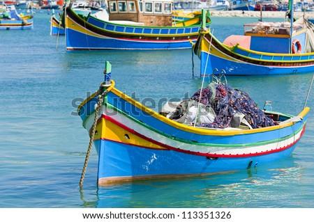 Fishing boats in Marsaxlokk Malta - stock photo