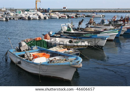 Fishing boats in Olhao's harbour in the Algarve, south coast of Portugal. - stock photo
