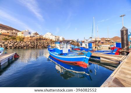 Fishing boats in port in Gran Tarajal, Fuerteventura - stock photo