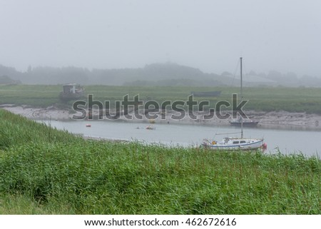 Fishing boats in the fog