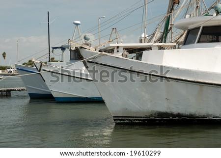 Fishing boats in the harbor of Corpus Christi, TX USA - stock photo