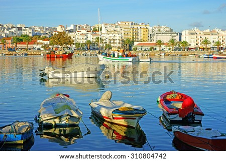 Fishing boats in the historic Harbor of Lagos on a beautiful summers day, Lagos, The Algarve, Portugal - stock photo