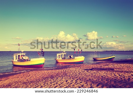 Fishing boats is moored in beach. Vintage toned photo.  - stock photo