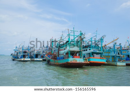 Fishing boats moored alongside the pier are a number of coastal areas. - stock photo