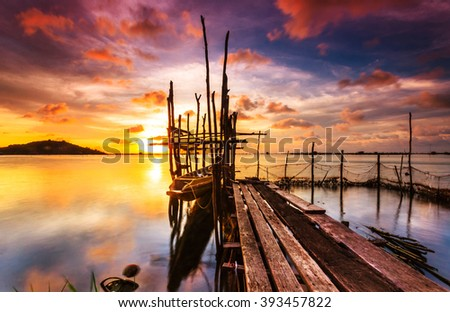 fishing boats  moored at sea. Clouds and light evening twilight and sunset. - stock photo