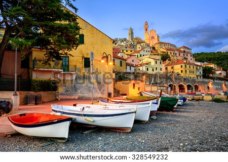 Fishing boats on a beach of medieval town Cervo on italian Riviera, Italy - stock photo