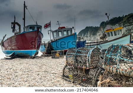 Fishing boats on Beer Beach, Dorset, England - stock photo