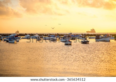 Fishing boats on Teresitas beach on the sunrise on Tenerife island, Spain