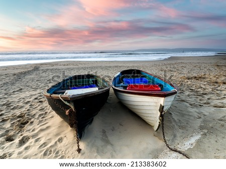 Fishing boats on the beach at Durley Chine, part of Bournemouth beach in Dorset - stock photo