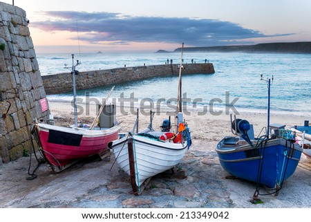 Fishing boats on the beach at Sennen Cove near Land's End in Cornwall - stock photo