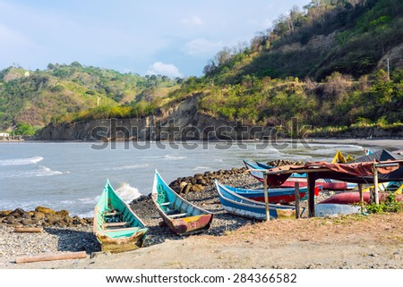 Fishing boats on the northern coast of Ecuador, Province of Esmeraldas - stock photo