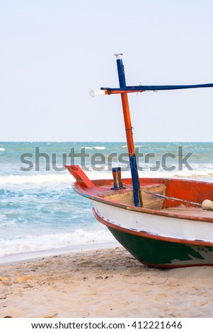 Fishing boats parked on the beach - stock photo