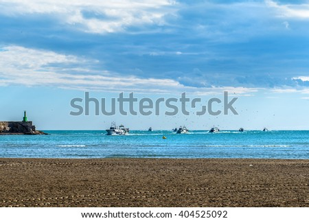 FIshing boats returning from fishing to the port of Peniscola, province of Castellon, Valencian Community, Spain. - stock photo