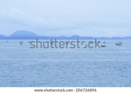 Fishing Boats Returning To Port - stock photo