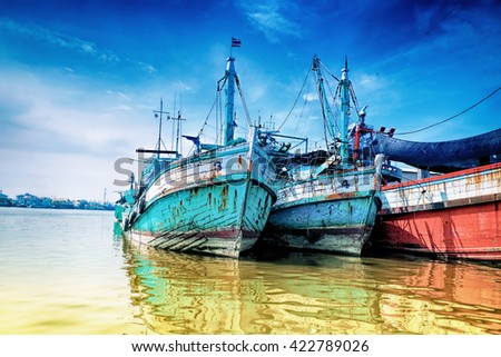 Fishing boats the rivers of Thailand. - stock photo