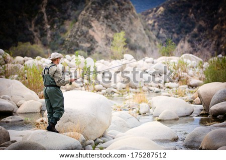 Fishing by the creek - stock photo