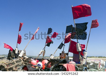 Fishing equipment; lobster and crab pots, nets flags etc  - stock photo