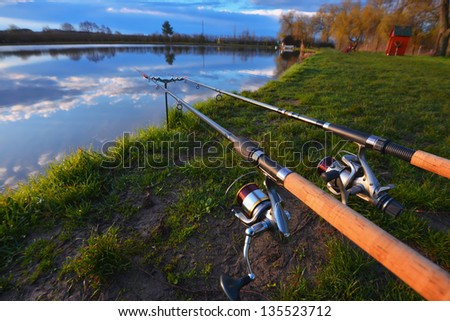 Fishing equipment on deck with beautiful view of a lake - stock photo