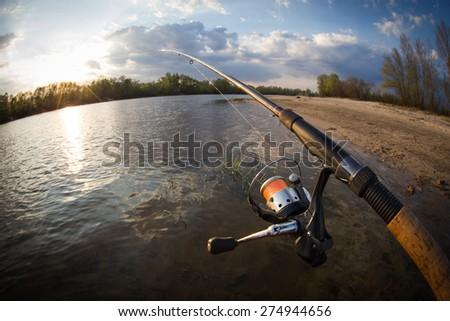 fishing. fishing in a river  - stock photo