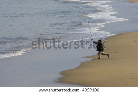 fishing from the beach - stock photo