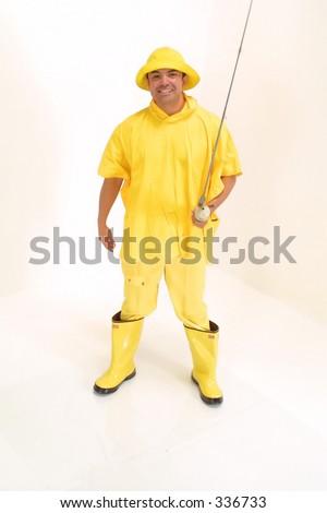 Fishing Fun Guy in rain gear on white background with fishing rod, - stock photo