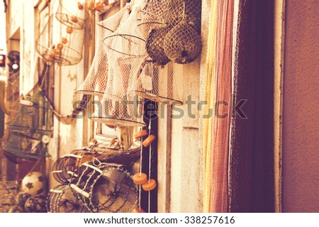 Fishing gear for sale. Portugal. Toned photo. - stock photo