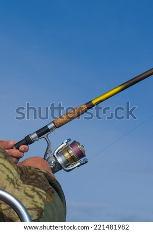 Fishing gear on blue sky background - stock photo