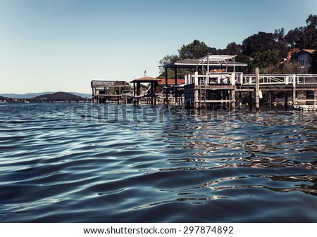 fishing hut on the Clear Lake. Summer day background. Landscape with river. - stock photo